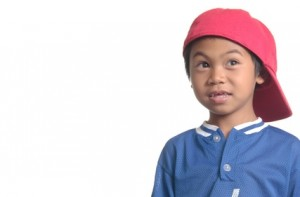 cute young boy in red baseball cap